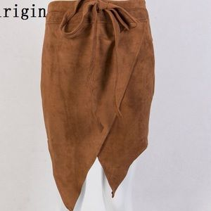 Dresses & Skirts - Tan suede wrap style skirt wear with animal print